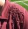 6-0305-1 Ķieģeļkrāsas jaka ar mežģīņu dekorējumu.